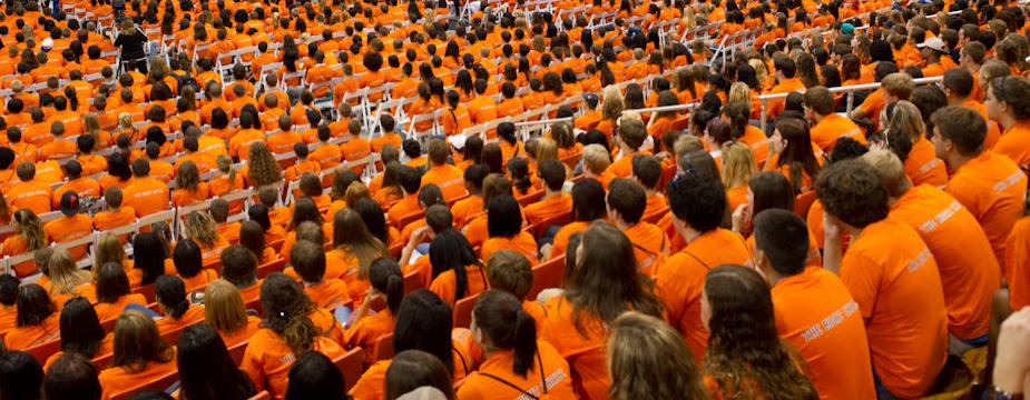 Gathering of freshman students wearing the school color: orange